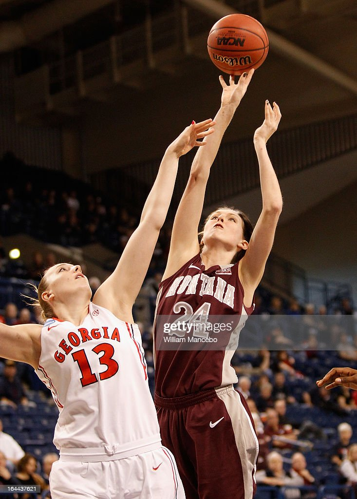 Carly Selvig #24 of the Montana Grizzlies shoots over Merritt Hempe #13 of the Georgia Lady Bulldogs during the game at McCarthey Athletic Center on March 23, 2013 in Spokane, Washington. The Lady Bulldogs defeated the Grizzlies 70-50.