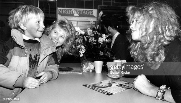 Carly Simon chats with Ricky Corliss and his mother Marilyn of Leominster at the Tower Records store in Boston on Nov 29 1988