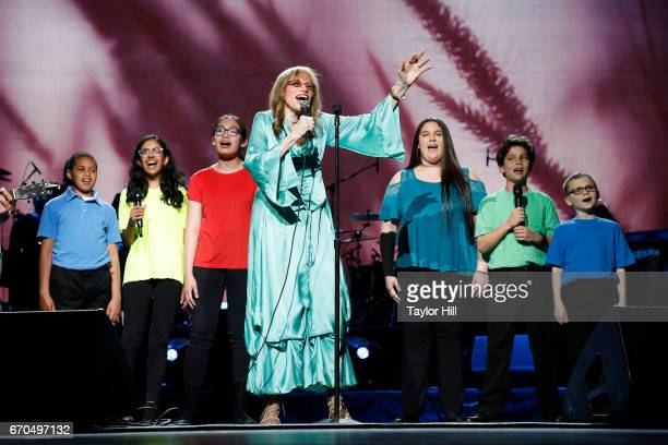 Carly Simon performs during the 2017 Tribeca Film Festival Opening Gala premiere of 'Clive Davis The Soundtrack of our Lives' at Radio City Music...