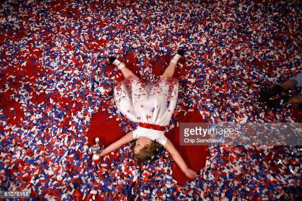 Carly Smith of Charleston West Virginia plays in the confetti after a rally for Democratic presidential hopeful Sen Hillary Clinton at the Charleston...