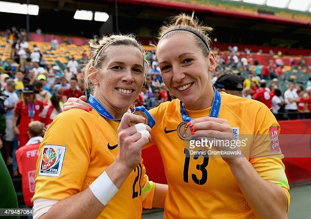 Carly Telford and Siobhan Chamberlain of England celebrate after the FIFA Women's World Cup Canada 2015 Third Place Playoff match between Germany and...