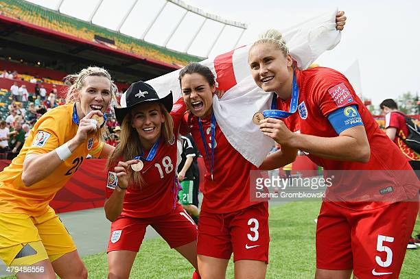 Carly Telford Toni Duggan Claire Rafferty and Steph Houghton of England celebrate their third place in the FIFA Women's World Cup Canada 2015 Third...