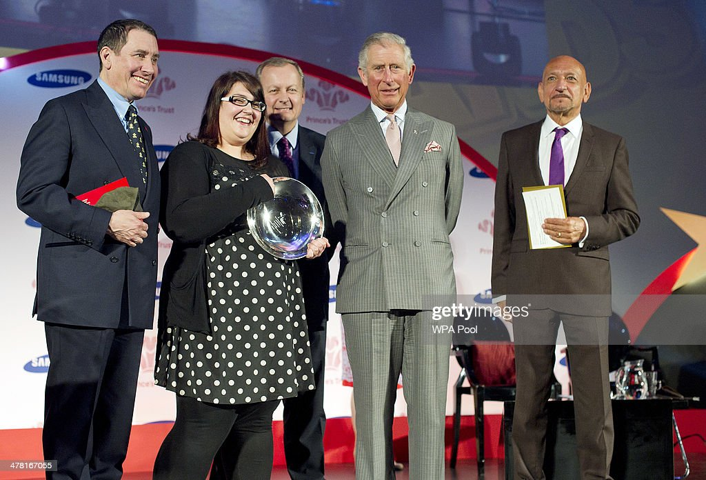 Carly Williams, 21, (2L) from Weston-Super-Mare receives the Samsaung Young Achiever of the Year Award from Prince Charles, Prince of Wales as Jools Holland OBE and Sir Ben Kingsley CBE look on at the Prince's Trust & Samsung Celebrate Success awards at Odeon Leicester Square on March 12, 2014 in London, England.