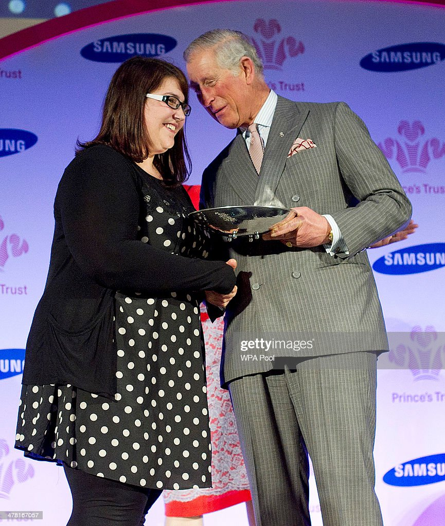 Carly Williams, 21, from Weston-Super-Mare receives the Samsaung Young Achiever of the Year Award from <a gi-track='captionPersonalityLinkClicked' href=/galleries/search?phrase=Prince+Charles+-+Prince+of+Wales&family=editorial&specificpeople=160180 ng-click='$event.stopPropagation()'>Prince Charles</a>, Prince of Wales at the Prince's Trust & Samsung Celebrate Success awards at Odeon Leicester Square on March 12, 2014 in London, England.