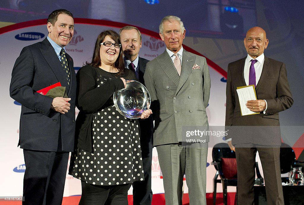 Carly Williams, 21, (2L) from Weston-Super-Mare receives the Samsaung Young Achiever of the Year Award from <a gi-track='captionPersonalityLinkClicked' href=/galleries/search?phrase=Prince+Charles+-+Prince+of+Wales&family=editorial&specificpeople=160180 ng-click='$event.stopPropagation()'>Prince Charles</a>, Prince of Wales as Jools Holland OBE and Sir Ben Kingsley CBE look on at the Prince's Trust & Samsung Celebrate Success awards at Odeon Leicester Square on March 12, 2014 in London, England.