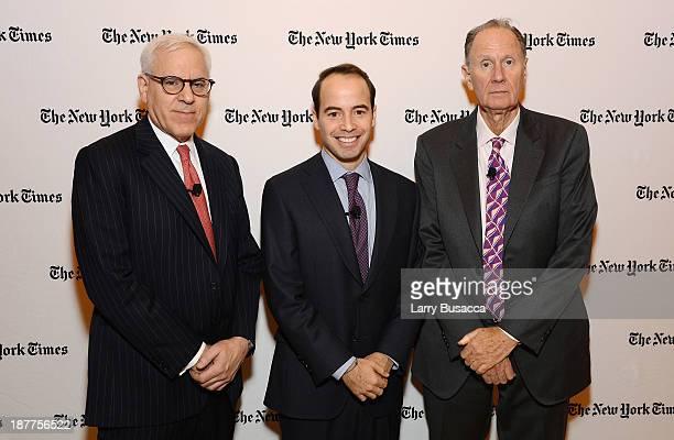 Carlyle Group cofounder David Rubenstein DealBook reporter Peter Lattman and founding partner at TPG Capital David Bonderman attend the New York...