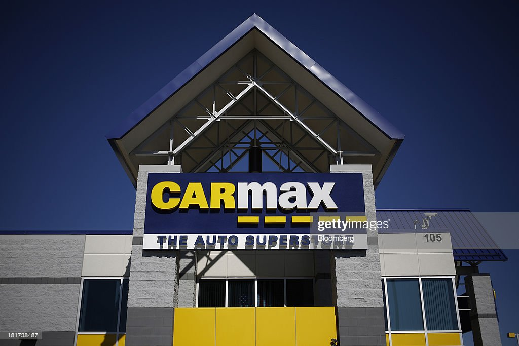 CarMax Inc. signage hangs on the front of a dealership in Lexington, Kentucky, U.S., on Monday, Sept. 23, 2013. Carmax, which generates 98% of its revenue in the used car market, today reported record second quarter results for the quarter ended Aug. 31. Photographer: Luke Sharrett/Bloomberg via Getty Images