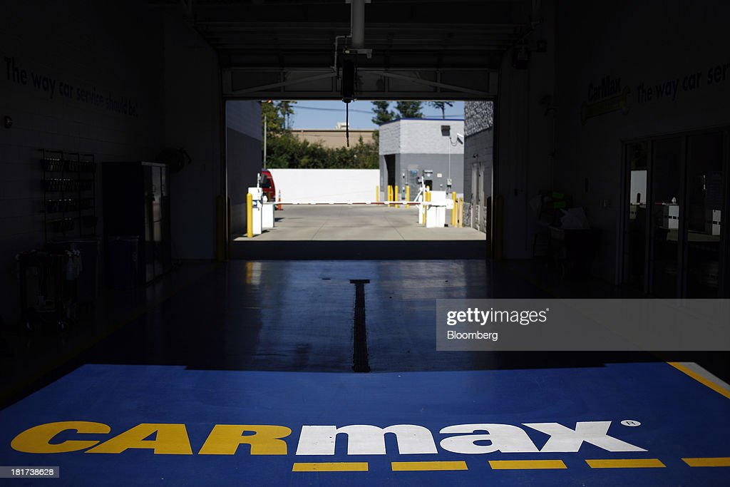 CarMax Inc. signage is seen in the service bay of a dealership in Lexington, Kentucky, U.S., on Monday, Sept. 23, 2013. Carmax, which generates 98% of its revenue in the used car market, today reported record second quarter results for the quarter ended Aug. 31. Photographer: Luke Sharrett/Bloomberg via Getty Images