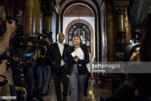 Carme Forcadell Catalonia's parliament president center arrives for a meeting inside the Generalitat regional government offices in Barcelona Spain...