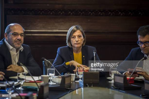 Carme Forcadell Catalonia's parliament president center attends a meeting inside the Generalitat regional government offices in Barcelona Spain on...