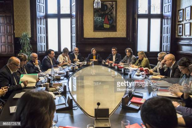 Carme Forcadell Catalonia's parliament president center attends a meeting with parliamentary leaders inside the Generalitat regional government...