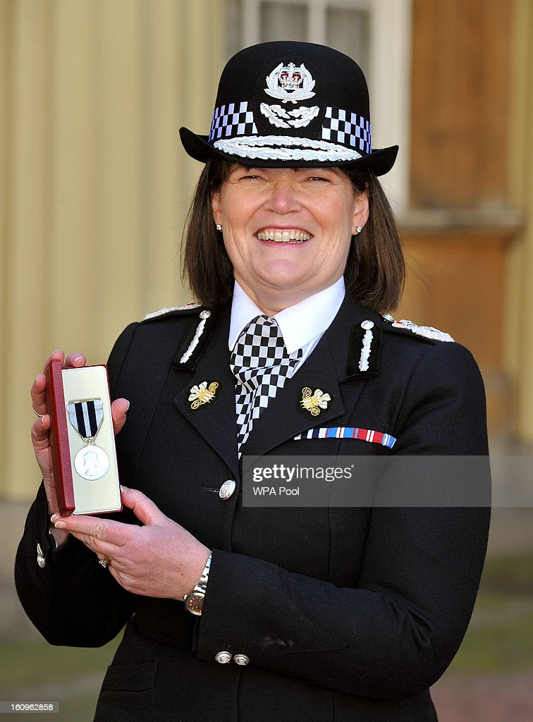 Carmel Napier the Chief Constable of Gwent Police proudly holds her Police Medal, after it was presented to her by the Prince of Wales at an Investiture Ceremony, in Buckingham Palace on February 8, 2013 in London, England.