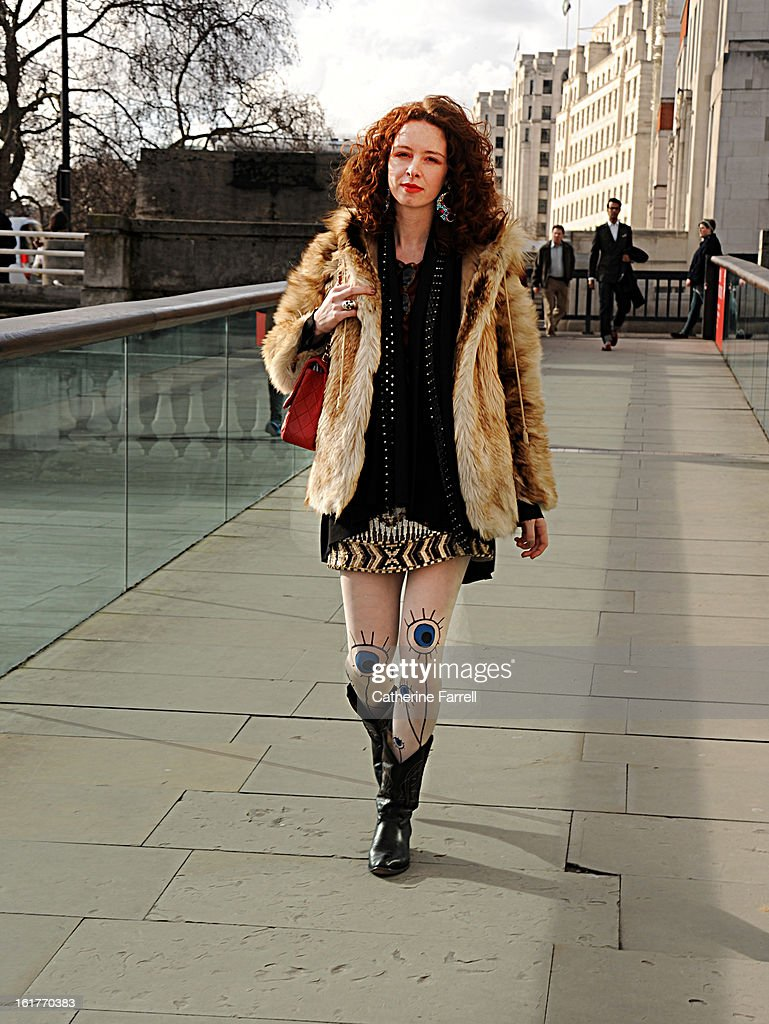 Carmel Walsh, stylist at Luisa via Roma, wears a Luna Monta jacket, a vintage fun fur coat, Manuela Bicocchi original leather weave scarf, an All Saints shirt Le Quelle de Sardine patterned tights, ethnic Mexican cowboy boots, on February 15, 2013 in London, England.