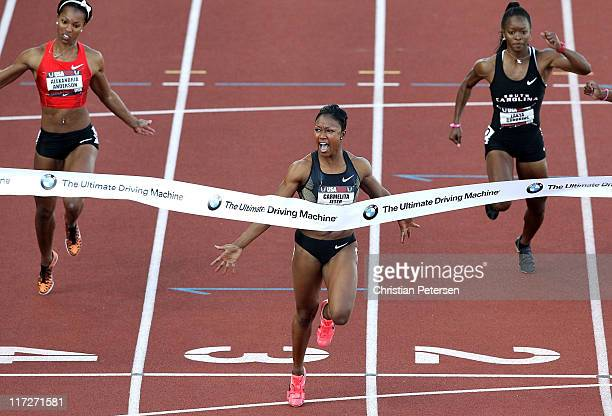 Carmelita Jeter celebrates as she crosses the finish line to win the Women's 100 meter dash final on day two of the USA Outdoor Track Field...