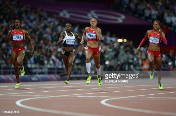 US' Carmelita Jeter Ivory Coast's Murielle Ahoure US' Allyson Felix US' Sanya RichardsRoss compete in the women's 200m final at the athletics event...