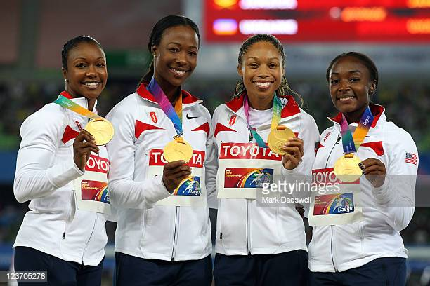 Carmelita Jeter Marshevet Myers Allyson Felix and Bianca Knight of the USA pose with their gold medals during the medal ceremony for the women's...