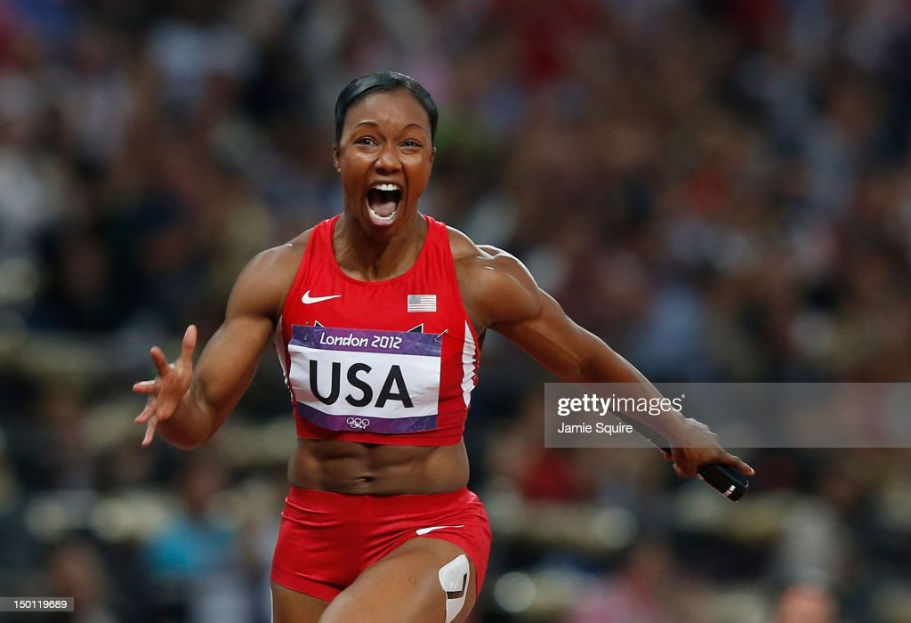 <a gi-track='captionPersonalityLinkClicked' href=/galleries/search?phrase=Carmelita+Jeter&family=editorial&specificpeople=4472760 ng-click='$event.stopPropagation()'>Carmelita Jeter</a> of the United States celebrates winning gold in the Women's 4 x 100m Relay Final on Day 14 of the London 2012 Olympic Games at Olympic Stadium on August 10, 2012 in London, England.