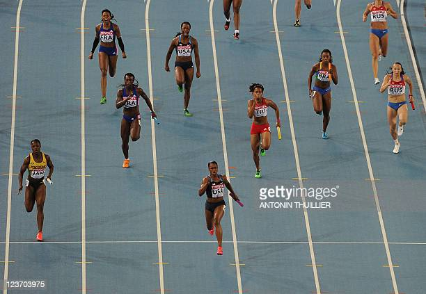 US Carmelita Jeter wins in the women's 4x100 metres relay final at the International Association of Athletics Federations World Championships in...
