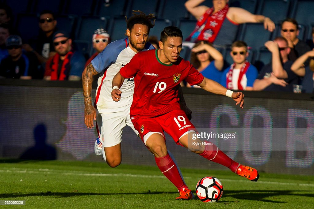 Carmelo Algaranaz #19 of Bolivia drives past Jermaine Jones #13 of USA late in the first half of the COPA America Centenario USA 2016 on May 28, 2016 at Children's Mercy Park in Kansas City, Kansas.