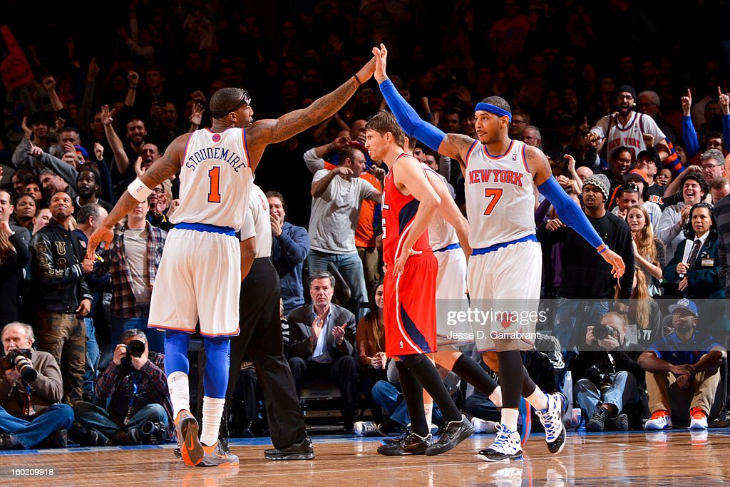 Carmelo Anthony #7 and Amar'e Stoudemire #1 of the New York Knicks celebrate while playing the Atlanta Hawks at Madison Square Garden on January 27, 2013 in New York, New York.