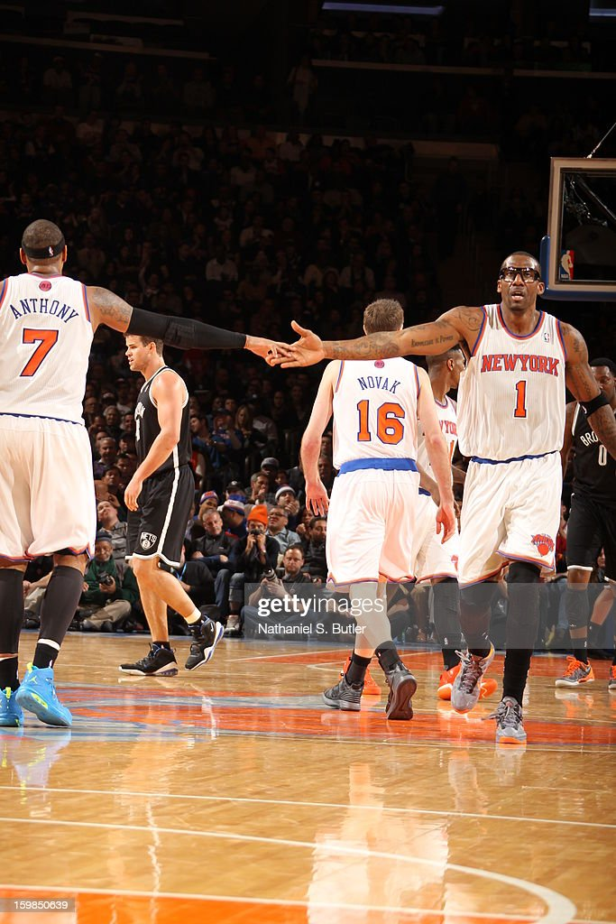 Carmelo Anthony #7 and Amar'e Stoudemire #1 of the New York Knicks high five during the game against the Brooklyn Nets on January 21, 2013 at Madison Square Garden in New York City.
