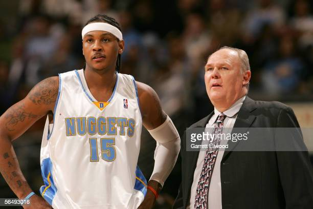 Carmelo Anthony and head coach George Karl of the Denver Nuggets stand during the game against the Philadelphia 76ers on December 27 2005 at the...