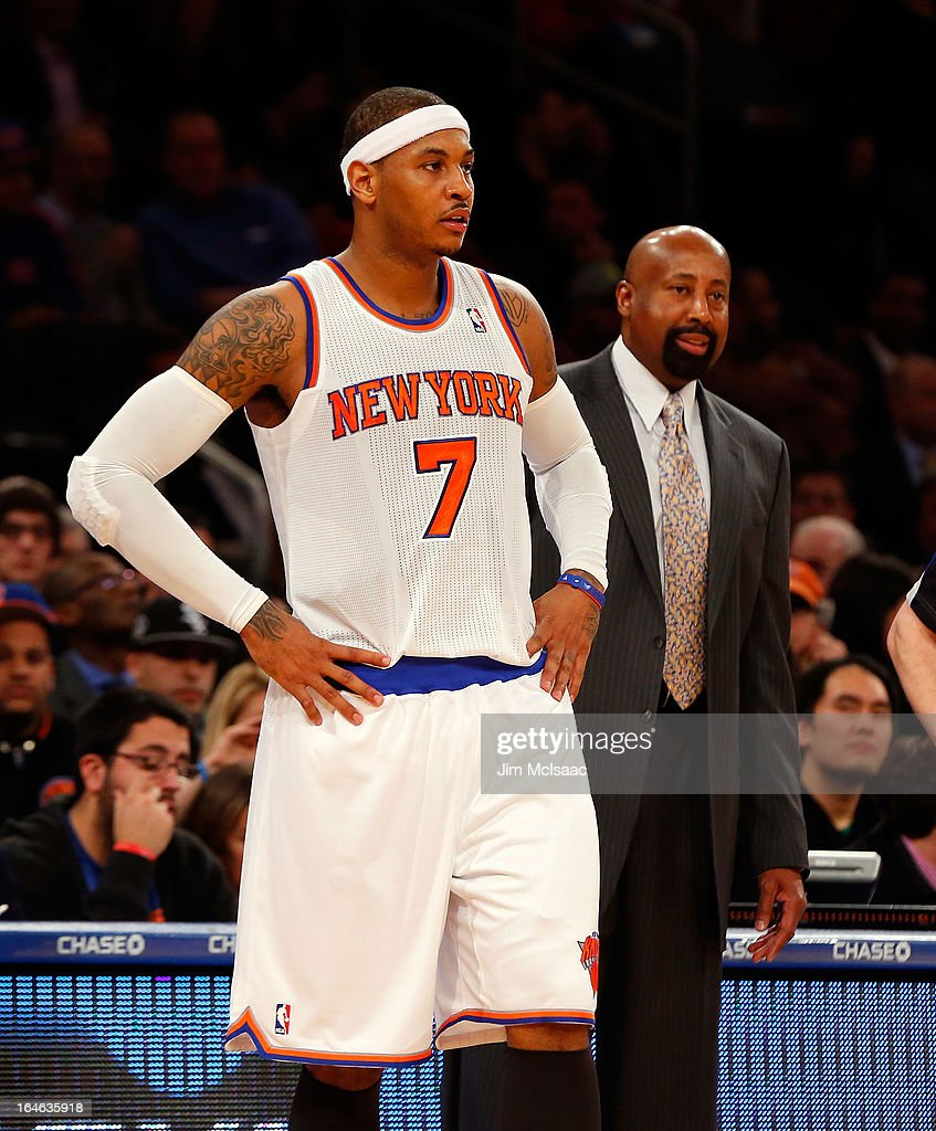 Carmelo Anthony #7 and head coach Mike Woodson of the New York Knicks in action against the Toronto Raptors at Madison Square Garden on February 13, 2013 in New York City. The Raptors defeated the Knicks 92-88.