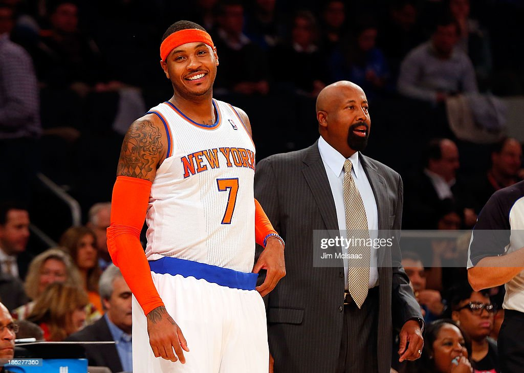 Carmelo Anthony #7 and head coach Mike Woodson of the New York Knicks look on against the Charlotte Bobcats during a pre-season game at Madison Square Garden on October 25, 2013 in New York City. The Bobcats defeated the Knicks 85-83.