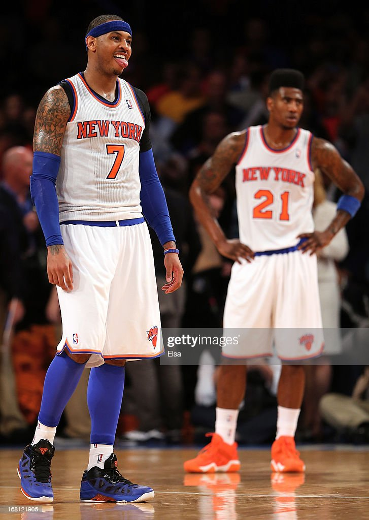 <a gi-track='captionPersonalityLinkClicked' href=/galleries/search?phrase=Carmelo+Anthony&family=editorial&specificpeople=201494 ng-click='$event.stopPropagation()'>Carmelo Anthony</a> #7 and <a gi-track='captionPersonalityLinkClicked' href=/galleries/search?phrase=Iman+Shumpert&family=editorial&specificpeople=5042486 ng-click='$event.stopPropagation()'>Iman Shumpert</a> #21 of the New York Knicks react as the game ends against the Indiana Pacers during Game One of the Eastern Conference Semifinals of the 2013 NBA Playoffs on May 5, 2013 at Madison Square Garden in New York City. The Indiana Pacers defeated the New York Knicks 102-95.