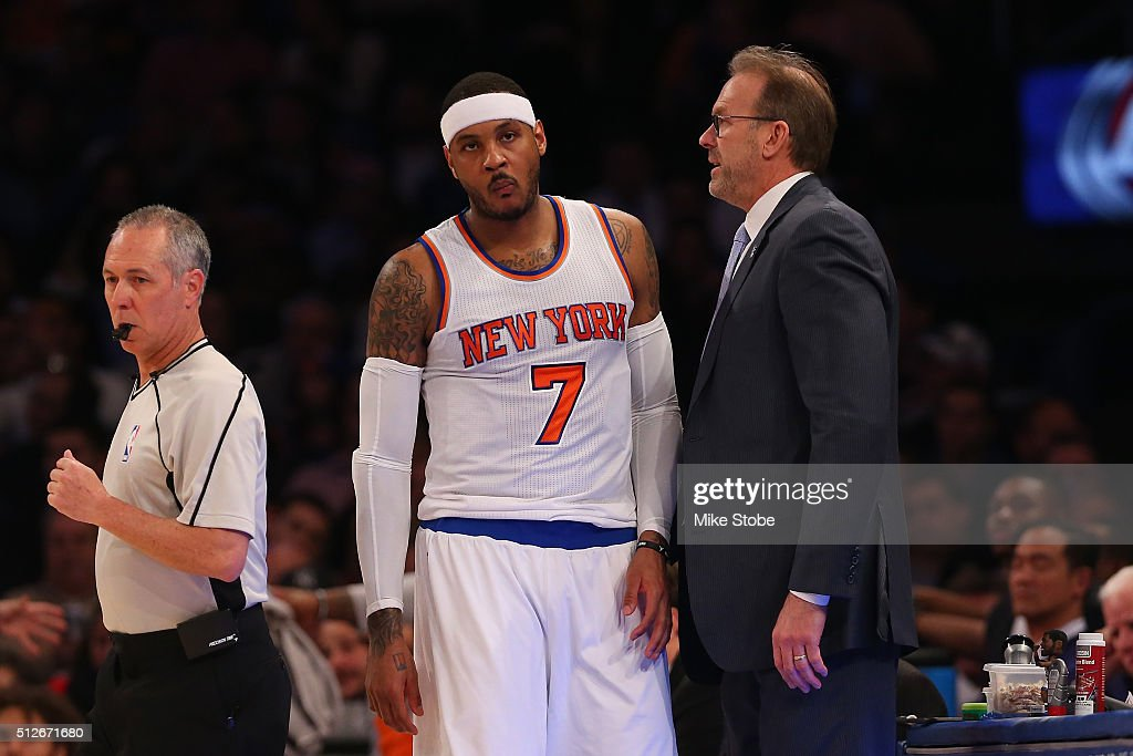 Carmelo Anthony and Interim Head Coach Kurt Rambis of the New York Knicks look on against the Orlando Magic at Madison Square Garden on February 26...