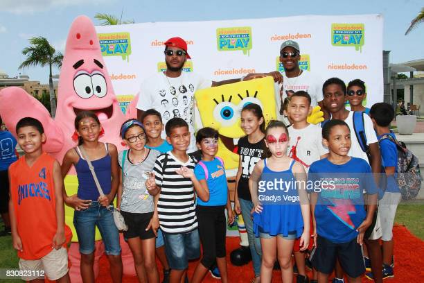 Carmelo Anthony and Jimmy Butler enjoy with kids and Nickelodeon Characters as part of Worldwide Day of Play at Bahia Urbana Bay Side Park on August...