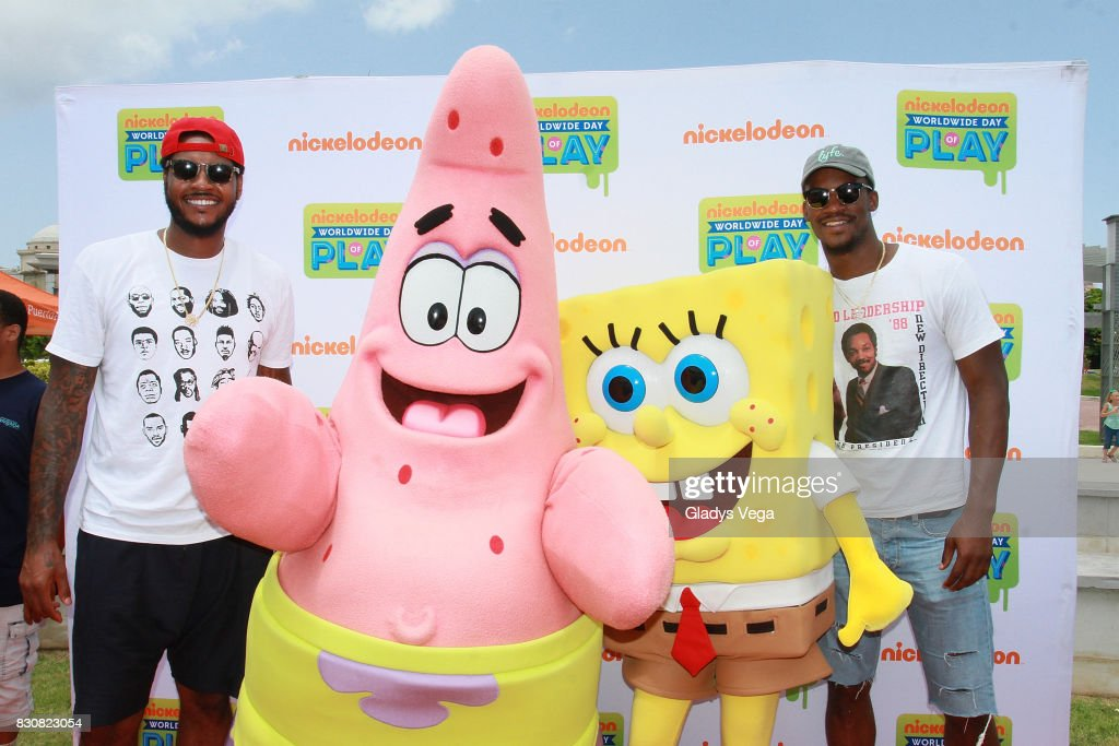 Carmelo Anthony and Jimmy Butler pose with Nickelodeon Characters as part of Worldwide Day of Play at Bahia Urbana Bay Side Park on August 12, 2017 in San Juan, Puerto Rico.