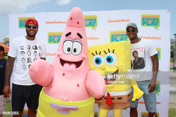 Carmelo Anthony and Jimmy Butler pose with Nickelodeon Characters as part of Worldwide Day of Play at Bahia Urbana Bay Side Park on August 12 2017 in...
