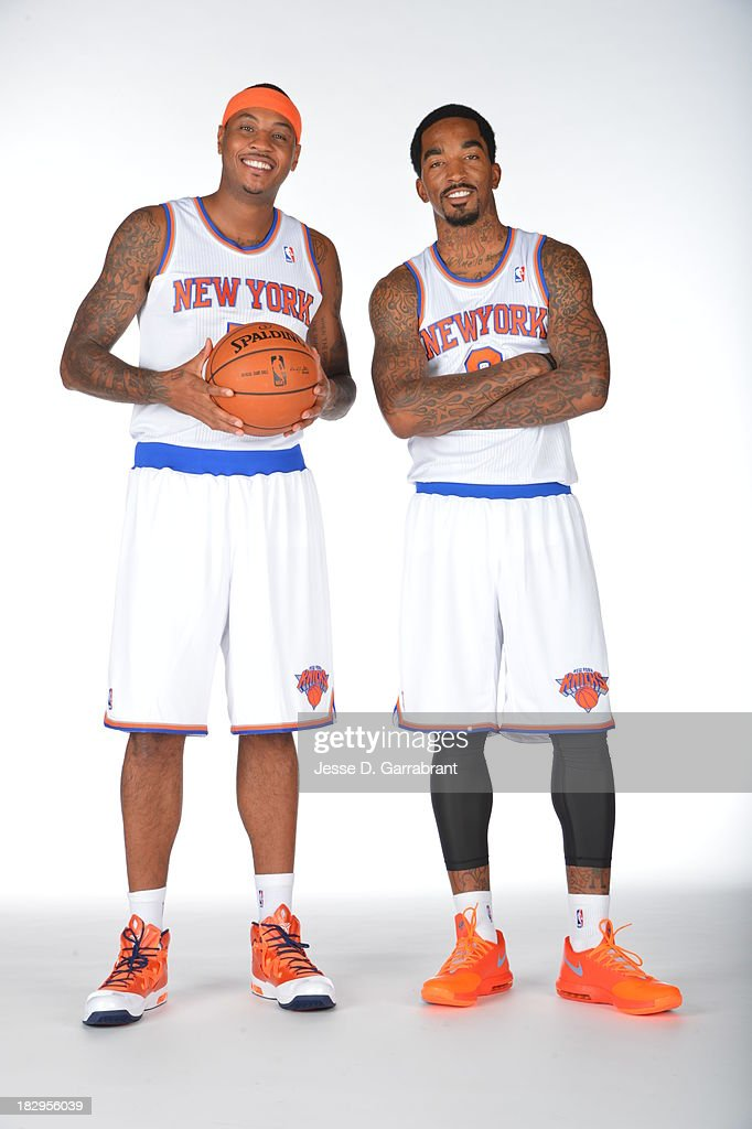 Carmelo Anthony #7 and J.R. Smith #8 of the New York Knicks pose for a portrait at Media Day on September 30, 2013 at Madison Square Garden in New York City, New York.