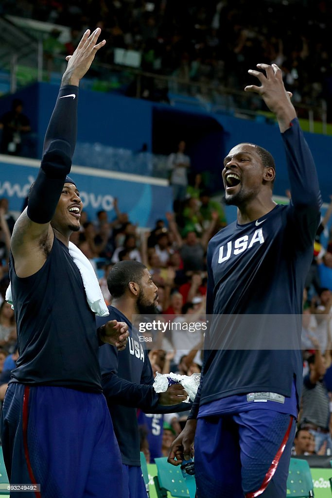 Carmelo Anthony and Kevin Durant of United States celebrate after defeating Serbia during the Men's Gold medal game on Day 16 of the Rio 2016 Olympic...