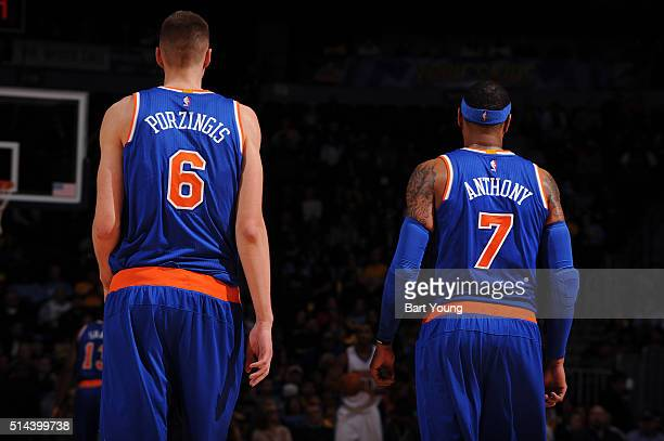 Carmelo Anthony and Kristaps Porzingis of the New York Knicks during the game against the Denver Nuggets on March 8 2016 at the Pepsi Center in...