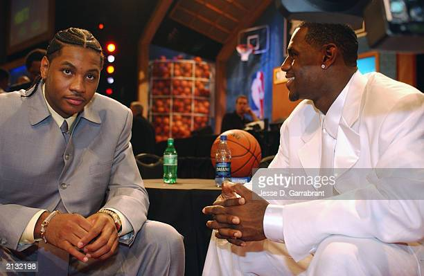 Carmelo Anthony and LeBron James talk during the 2003 NBA Draft at the Paramount Theatre at Madison Square Garden on June 26 2003 in New York New...