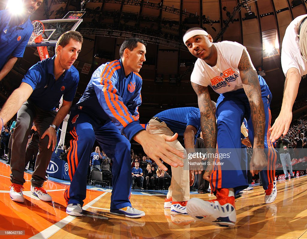 <a gi-track='captionPersonalityLinkClicked' href=/galleries/search?phrase=Carmelo+Anthony&family=editorial&specificpeople=201494 ng-click='$event.stopPropagation()'>Carmelo Anthony</a> #7 and <a gi-track='captionPersonalityLinkClicked' href=/galleries/search?phrase=Pablo+Prigioni&family=editorial&specificpeople=664673 ng-click='$event.stopPropagation()'>Pablo Prigioni</a> #9 of the New York Knicks pre-game against the Denver Nuggets on December 9, 2012 at Madison Square Garden in New York City.