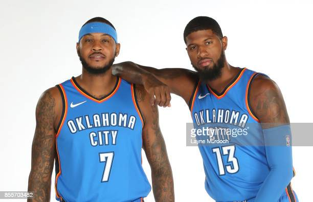 Carmelo Anthony and Paul George of the Oklahoma City Thunder pose for a portrait during the 2017 NBA Media Day on September 25 2017 at the Chesapeake...