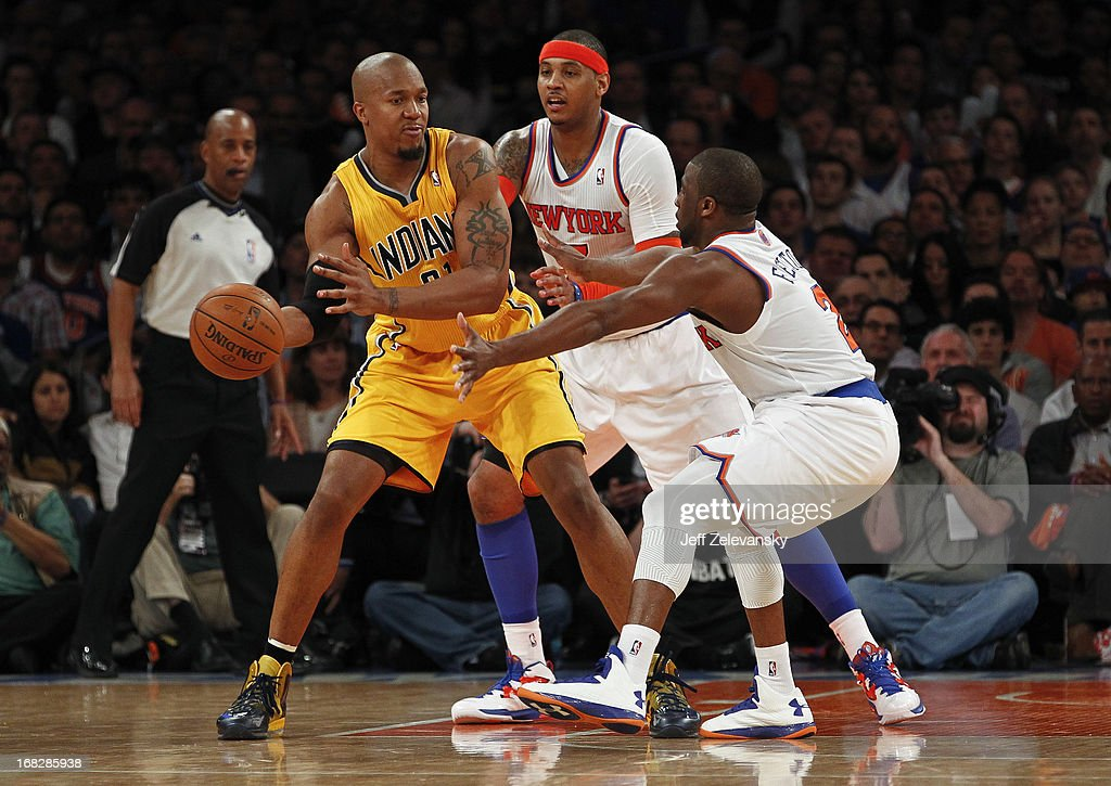 Carmelo Anthony and Raymond Felton of the New York Knicks guard David West of the Indiana Pacers during Game Two of the Eastern Conference Semifinals...