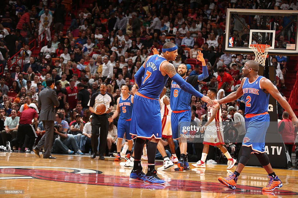 Carmelo Anthony #7 and Raymond Felton #2 of the New York Knicks shake hands against the Miami Heat during a game on April 2, 2013 at American Airlines Arena in Miami, Florida.