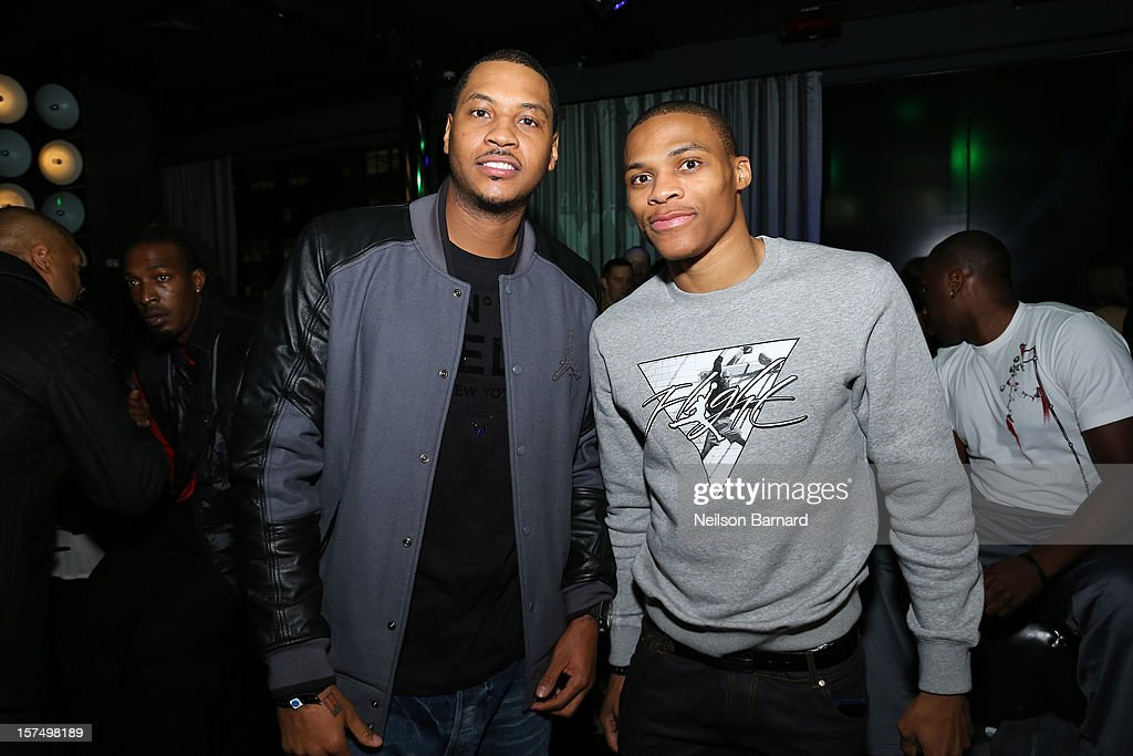 Carmelo Anthony (L) and Russell Westbrook attend the Dare To Fly AJXX8 event at PH-D Rooftop Lounge at Dream Downtown on December 3, 2012 in New York City.
