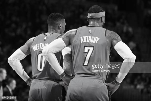 Carmelo Anthony and Russell Westbrook of the Oklahoma City Thunder looks on during the game against the Denver Nuggets on November 9 2017 at the...