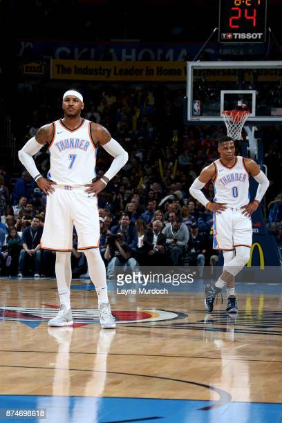 Carmelo Anthony and Russell Westbrook of the Oklahoma City Thunder look on during the game against the Chicago Bulls on November 15 2017 at...