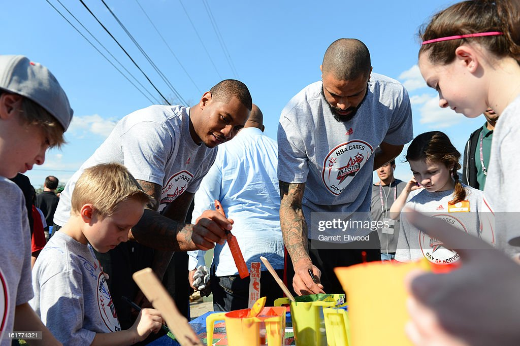 Carmelo Anthony #7 and Tyson Chandler #6 of the New York Knicks work together at the 2013 NBA Cares Day of Service at the Playground Build with KaBOOM! on February 15, 2013 in Houston, Texas.