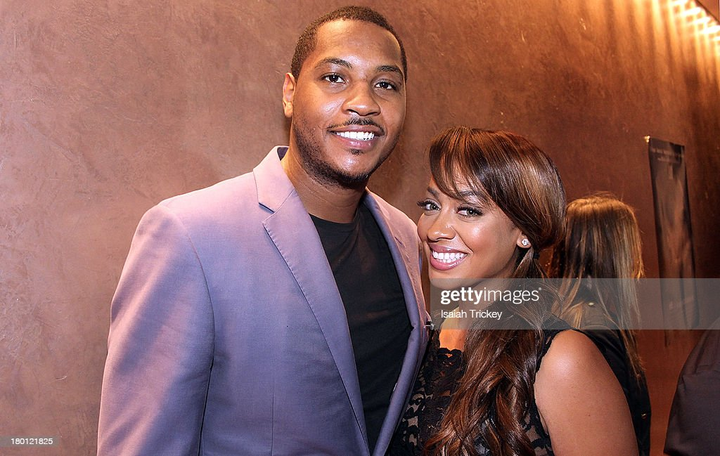 <a gi-track='captionPersonalityLinkClicked' href=/galleries/search?phrase=Carmelo+Anthony&family=editorial&specificpeople=201494 ng-click='$event.stopPropagation()'>Carmelo Anthony</a> and Wife <a gi-track='captionPersonalityLinkClicked' href=/galleries/search?phrase=La+La+Anthony&family=editorial&specificpeople=209433 ng-click='$event.stopPropagation()'>La La Anthony</a> are sighted at Isabel Bader Theatre on September 8, 2013 in Toronto, Canada.