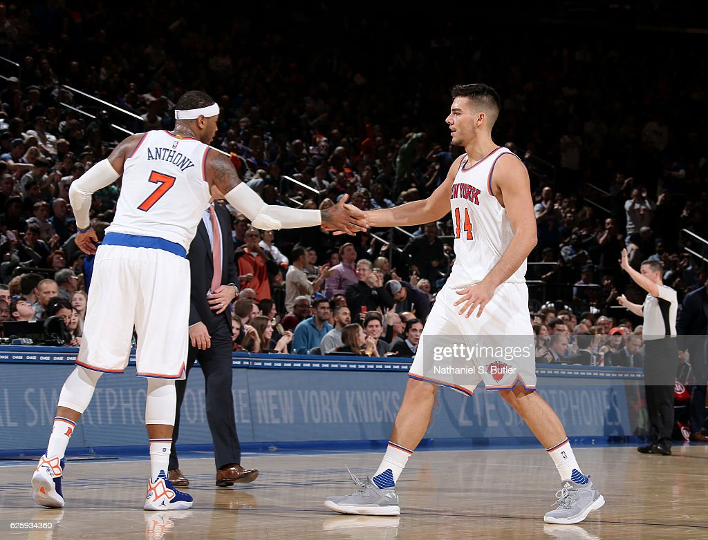 Carmelo Anthony #7 and Willy Hernangomez #14 of the New York Knicks high five during the game against the Charlotte Hornets at Madison Square Garden in New York, New York.