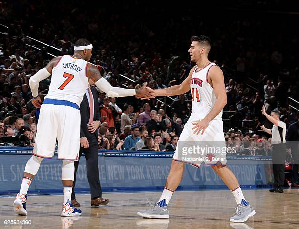 Carmelo Anthony and Willy Hernangomez of the New York Knicks high five during the game against the Charlotte Hornets at Madison Square Garden in New...