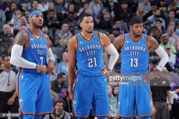 Carmelo Anthony Andre Roberson and Paul George of the Oklahoma City Thunder face the Sacramento Kings on November 7 2017 at Golden 1 Center in...