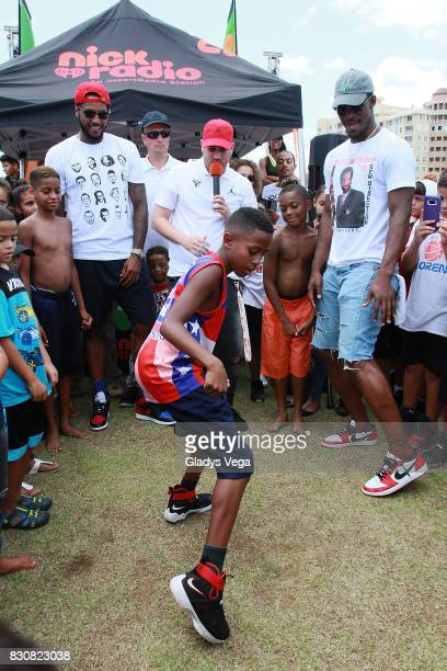 Carmelo Anthony Danilo Beauchamp and Jimmy Butler participate with kids of Worldwide Day of Play at Bahia Urbana Bay Side Park on August 12 2017 in...